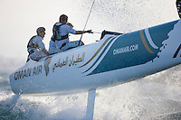 Extreme Sailing Series 2011. Leg 1. Muscat. Oman.Day 2 of racing. Oman Air, skippered by Sidney Gavignet with Nasser Al Mashari,David Carr and Kinley Fowler