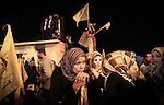 Friends and family members wait for the release of 26 Palestinian prisoners at the Erez crossing between Israel and the northern Gaza Strip on December 31, 2013. The 26 prisoners expected to be released later in the evening were jailed before the signing of the 1993 Oslo accords, which formally launched the Middle East peace process, and have served 19 to 28 years for killing Israeli civilians or soldiers. Photo by Ezz Zanoun
