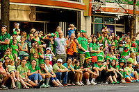 Photography of the Charlotte NC St. Patrick's Day Parade in March 2012. Image shows spectators watching the parade along Tryon Street. Photography is part of a series of St. Patrick's Day Parade photos in Charlotte, NC.