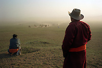 Khui Doloon Khudag, Mongolia, July 2003..Competitors & spectators at the horse racing in the national Naadam 40 kilometres outside Ulaanbaatar..Coaches watching racers approach.