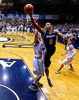 INDIANAPOLIS, IN - FEBRUARY 19: Andre Marhold #0 of the Duquesne Dukes shoots the ball around Andrew Smith #44 of the Butler Bulldogs at Hinkle Fieldhouse on February 19, 2013 in Indianapolis, Indiana. Butler defeated Duquesne 68-49. (Photo by Michael Hickey/Getty Images) *** Local Caption *** Andre Marhold; Andrew Smith