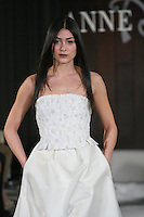 Model walks runway in a De Niro wedding dress by Anne Bowen, for the Anne Bowen Bridal Spring 2012 runway show.