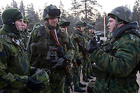 Kamenka, Karelia, Russia, 14/12/2007..A translator [left] assists a Swedish officer [centre] and a Russian officer [right] during Snezhinka [Snowflake] 2007, a joint live fire training exercise for Russian and Swedish motorised infantry in which they play the roles of a combined peace-keeping force enforcing a demilitarised zone in a warring region.