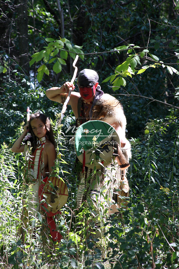 Native American Indian warriors hunting in the woods