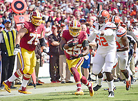 Washington Redskins running back Chris Thompson (25) carries the ball in the first quarter against the Cleveland Browns at FedEx Field in Landover, Maryland on October 2, 2016.  Also pictured is Washington Redskins offensive guard Brandon Scherff (75).  Cleveland Browns Cleveland Browns linebacker Corey Lemonier (52) and  inside linebacker Chris Kirksey (58) defend on the play.<br /> Credit: Ron Sachs / CNP /MediaPunch ***EDITORIAL USE ONLY***