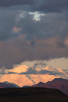 The north and south summits of Mt McKinley are visible under overlying clouds, Denali National Park.