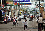 """Traffic moves along the main corridor of Guatemala's border town, Tecun Uman, which is situated along the Suchiate River, across from Hidalgo, Mexico, on Tuesday, May 8, 2007. The town's population of about 27,000 inhabitants fluctuates with the thousands of migrants that pass through every year. Tecun Uman also gained a nickname, """"Little Tijuana"""", from the seediness grown from the bars, brothels and drug trafficking that caters to the transient community since the early 1990's."""