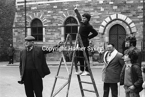 Hurling the Silver Ball. St Columb, Cornwall. England 1974. Robert Weldon 14yrs old is the youngest player ever to score a goal for Country side on Shrove Tuesday. He throws the Silver Ball up for the return game the following week. The town crier with his bell is Dick May.