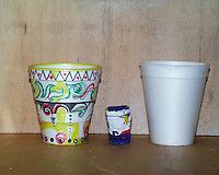 Styrofoam cups: normal (right), decorated (left), and shrunken to shot-glass size by pressure during an Alvin deep-sea dive.