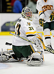 18 October 2009: University of Vermont Catamount goaltender Mike Spillane, a Senior from Bow, NH, warms up prior to a game against the Boston College Eagles at Gutterson Fieldhouse in Burlington, Vermont. The Catamounts defeated the Eagles 4-1 to open Vermont's America East hockey season. Mandatory Credit: Ed Wolfstein Photo