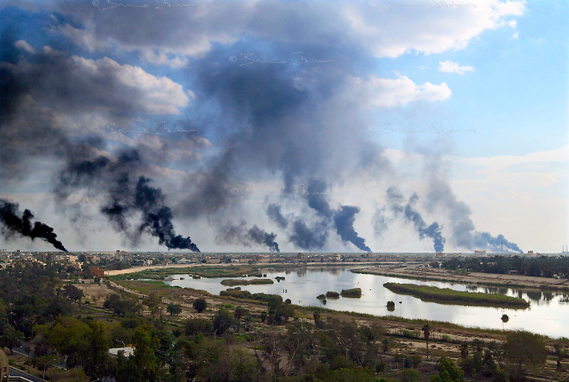 Baghdad, Iraq, March 22, 2003.Oil fires surround Baghdad in an unsuccessful attempt by the Iraqi army to prevent or disrupt US air strikes.