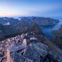 Twilight light over mountain landscape from rocky summit of Hermannsdalstinden, Moskenesoy, Lofoten Islands, Norway
