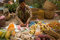 A woman selling vegetables at the market in Luang Prabang, Laos.
