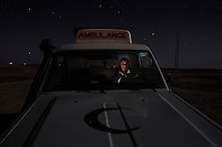 Mohamed Lamin Slot, 26, ambulance driver. Pictured in the desert near Rabouni refugee camp: 'I was born in El Aaiun camp in 1983. I grew up here, we got accustomed to it. I studied in Algeria for six years. I started working as an ambulance driver in 2005, it is a great job and I like it. There is a lot of tiredness but I like to help people. It took one year to train in first aid, it was very difficult at first, you remember many bad things like blood and injuries but now it's normal for me. We never rest there are always emergencies, maybe there are eight or nine cases per day. I work from Saturday to Friday and work the whole week even sleeping in the hospital, then I have the following week off. I get almost no sleep during that week. The hardest thing is when people die on the way to the hospital, you wish you could have got them there but you couldn't.'..