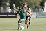 26 July 2009: Eniola Aluko (9) of Saint Louis Athletica moves the ball past Tina DiMartino (5) of FC Gold Pride.  Saint Louis Athletica tied the visiting FC Gold Pride 1-1 in a regular season Women's Professional Soccer game at Anheuser-Busch Soccer Park, in Fenton, MO.