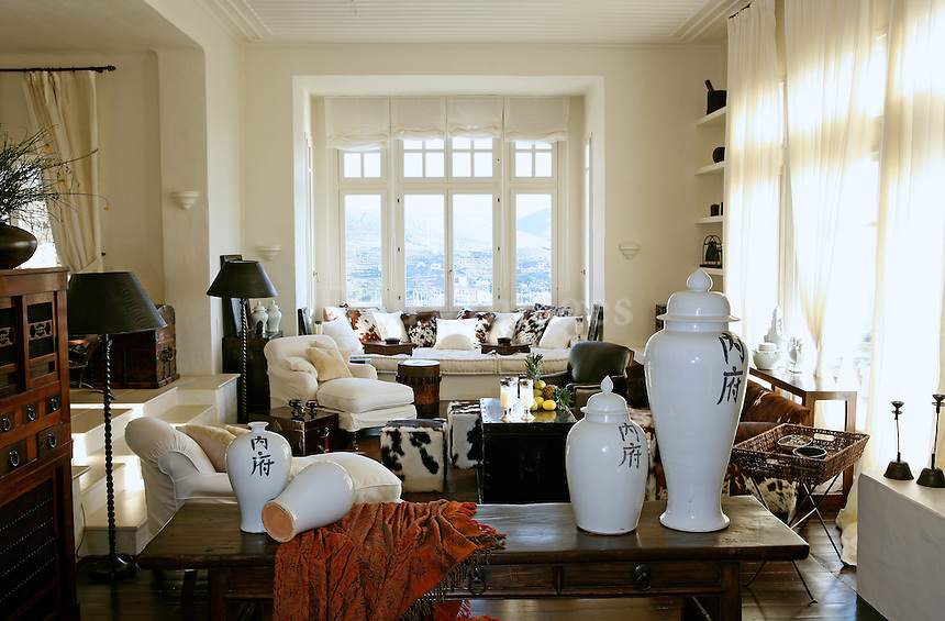 The island of Tzia in Greece belongs to those rare exceptions to the Cycladic architectural rule: white is not the predominant colour here.This particular residence, located on the top of a hill with a fabulous view of Vourkari bay. It comprises of seven rooms arranged over two floors. .