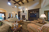 Large Mediterranean style open family room in neutral tones, high wood beamed ceilings and clerestory windows