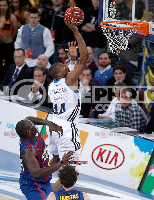 Real Madrid's Marcus Slaughter (r) and FC Barcelona Regal's Nathan Jawai during Spanish Basketball King's Cup match.February 07,2013. (ALTERPHOTOS/Acero) /Nortephoto