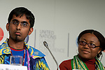 Krishneil Narayan and Esther Agbarakwe listen to a speaker at the Youth Press Conference at COP 15. (Images free for Editorial Web usage for Fresh Air Participants during COP 15. Credit: Robert vanWaarden)