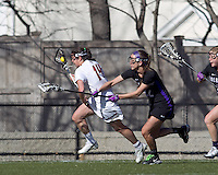 Boston College midfielder Sam Taylor (14) on offense as University at Albany defender Jenn Primeau (22) defends. University at Albany defeated Boston College, 11-10, at Newton Campus Field, on March 30, 2011.