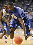 UK forward Patrick Patterson, guarded by  guard DeAndre Liggins, goes after a loose ball during the second period of the Blue and White scrimmage at Rupp Arena Wednesday night..Photo by Zach Brake | Staff