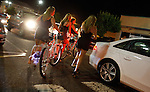 "A group of twenty-something women in high heels walk their bicycles across the Boulevard as they leave the ""Jersey Shore' house of MTV fame to go clubbing on an early Sunday morning in Seaside Heights. SEASIDE HEIGHTS, NJ  (8/18/2010)"