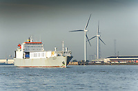 The RO-RO cargo ship, Undine steams downriver as she leaves the Port of Tilbury on the River Thames.