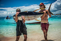 Namotu Island Resort, Fiji. Saturday January 31 2015) Ollie Black (AUS) and Mitch Hunter (AUS) with a 73 KG Yellow Fin Tuna.- The surf was in the 2' range for most of the day with the guests splitting themselves between SUPing at Namotu Lefts, surfing at Wilkes Passage and going fishing. The fishing boat was out twice today with success in the morning hooking up a 73 kg Yellow Fin tuna and the in the afternoon catching some Mahi Mahi, Skipjack Tuna and a Sailfish. The Sailfish was tagged and released. Photo: joliphotos.com