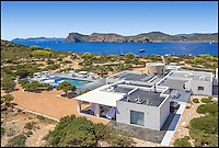 BNPS.co.uk (01202 558833)<br /> Pic: Kuhn&amp;Partner/BNPS<br /> <br /> The Ibizan-style villa, which sits in the middle of the island.<br /> <br /> Go on, push the boat out...<br /> <br /> Wealthy revellers wanting to spend their Ibiza holiday in the lap of luxury can now rent this entire island half a mile off the coast - but they will have to fork out a staggering &pound;12,000 a night for the privilege.<br /> <br /> Deep-pocketed holidaymakers can get a taste of life as a celebrity on 98-acre Tagomago Island, which features its own plush villa for 10 people, a fully-stocked bar and nine staff to wait on them hand and foot.<br /> <br /> Nestled in the crystal-clear turquoise waters of the Mediterranean, the tiny private island has recently played host to footballing star Cristiano Ronaldo and Rolling Stones guitarist Ronnie Wood.<br /> <br /> Tagomago can be hired for a whopping &pound;85,000 a week at the height of summer - the equivalent to &pound;500 an hour - but prices drop to an only slightly more affordable &pound;70,000 for the rest of the year.