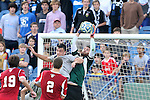 09 December 2012: Indiana's Luis Soffner (in green) catches the ball against the crossbar under pressure from Georgetown's Brandon Allen (10). The Georgetown University Hoyas played the Indiana University Hoosiers at Regions Park Stadium in Hoover, Alabama in the 2012 NCAA Division I Men's Soccer College Cup Final. Indiana won the game 1-0.