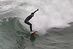 Surfers surf city surfer Surfing surfboard Seal Beach California.  Photograph by Alan Mahood.
