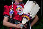 Indian Nation Pow Wow at Day Break Cultural Center in Discovery Park with woman posing with feather