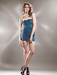 High fashion studio photo of a beautiful woman wearing a blue dress. The photo is not model released, however the model release can be acquired from the modeling agency if necessary. Agency's fees may apply depending on the usage.