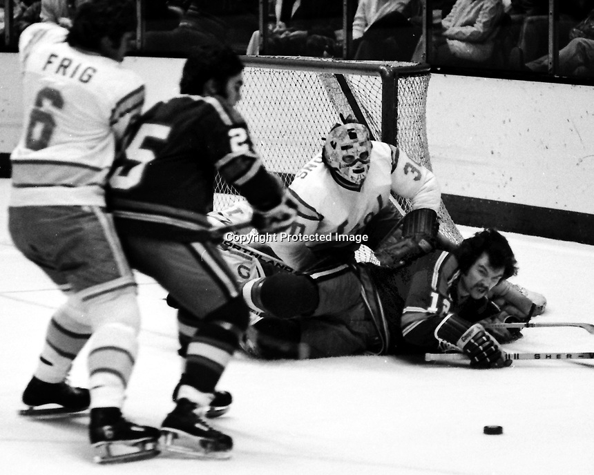 California Golden Seals vs Kansas City Scouts: Seals goalie Gary Simmons holds off Kansas City Scouts Robin Burns., Len Frig and Randy Rota..  (1975 photo by Ron Riesterer)