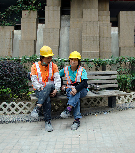 Hong Kong urban scene construction workers rest for lunch