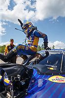 Jun 6, 2016; Epping , NH, USA; NHRA funny car driver Ron Capps celebrates after winning the New England Nationals at New England Dragway. Mandatory Credit: Mark J. Rebilas-USA TODAY Sports