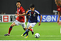 (R-L) Shinji Kagawa (JPN), Kim Jung-Woo (KOR),AUGUST 10, 2011 - Football / Soccer :Kirin Challenge Cup 2011 match between Japan 3-0 South Korea at Sapporo Dome in Sapporo, Hokkaido, Japan. (Photo by Takamoto Tokuhara/AFLO)