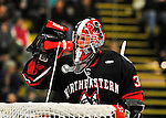 28 January 2012: Northeastern University Huskies' goaltender Chris Rawlings, a Junior from North Delta, British Columbia, hydrates in the third period during a break in the action against the University of Vermont Catamounts at Gutterson Fieldhouse in Burlington, Vermont. The Huskies defeated the Catamounts 4-2 in the second game of their 2-game Hockey East weekend series. Mandatory Credit: Ed Wolfstein Photo