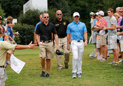 13.09.2014. Atlanta, GA, USA.   Rory McIlroy walks to the first tee box prior to the third round of the FedEx Cup - The Tour Championship at East Lake Golf Club in Atlanta, Georgia.