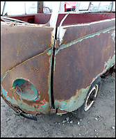 BNPS.co.uk (01202 558833)<br /> Pic: Tennants/BNPS<br /> <br /> Rust in peace...<br /> <br /> Jigsaw puzzle - VW camper in hundreds of pieces could be yours for...for &pound;20,000!<br /> <br /> Despite looking ready for the scrapheap, and even though the buyer will have to piece it together like a jigsaw, when fully restored the iconic vehicle could be worth &pound;100,000.<br /> <br /> The barn-find 1960 Type 2 split-screen 23-window Samba has been languishing in a barn for the last 20 years after its owner hauled it from the road, took it apart and stored it in pieces.<br /> <br /> Now being offered at auction, it represents the ultimate restoration project for a petrol head with time on their hands, although it will require tens of thousands of pounds worth of work before it's back to its former glory.<br /> <br /> The camper will be sold by Tennants Auctioneers in Leyburn, North Yorks, on March 25.