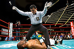 "The referee waves the fight off  while former world champion Carl Daniels is knocked out on the canvas during his 6 rounds Super Middleweight fight against ""Irish"" Andy Lee at the Garden in New York on 03.16.07..Lee won by 3rd round ko. Photo by Thierry Gourjon."