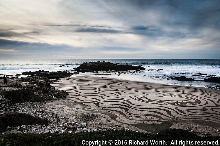 Using a garden rake as his brush, sand artist Jesse Meyer turned the sand at Pescadero State Beach into art on a warm winter afternoon.