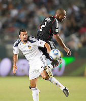 LA Galaxy forward Jovan Kirovski (9) and DC United defender Julius James (2) battle for the ball during the first half of the game between LA Galaxy and the D.C. United at the Home Depot Center in Carson, CA, on September 18, 2010. LA Galaxy 2, D.C. United 1.