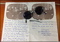 BNPS.co.uk (01202 558833)<br /> Pic: RyedaleAuctioneers/BNPS<br /> <br /> A letter from John's uncle Charlie, which explains how the sunglasses came in to his possession.<br /> <br /> A pair of John Lennon's sunglasses which he stamped on in a fit of rage but his uncle fetched out of a bin and had repaired has emerged for auction.<br /> <br /> The circular, metal framed glasses which Lennon is believed to have owned in the 1970s, post-Beatles, are tipped to sell for &pound;3,500.<br /> <br /> They are accompanied by a fascinating letter from his uncle Charlie Lennon explaining the incident in which they were broken.<br /> <br /> An irate Lennon, according to the letter, stamped on his glasses after an unhappy phone call and chucked them in the bin.