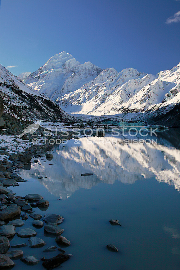 Snow covered Mt Cook / Aoraki is reflected in the Hooker Glacier terminal lake.