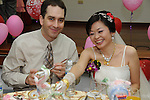 Taiwanese Wedding -- The newlyweds at the wedding banquet.