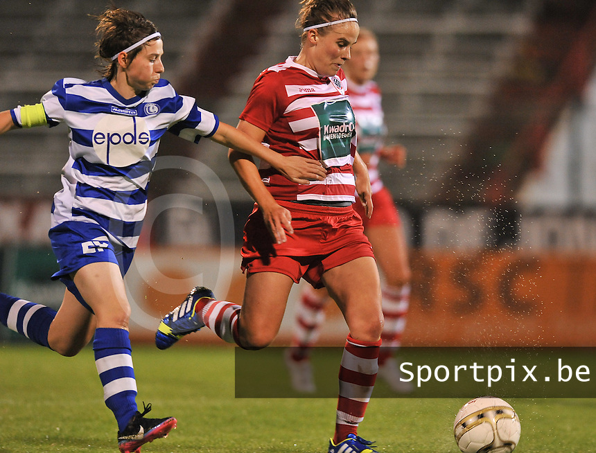 20130913 - ANTWERPEN , BELGIUM : Antwerp Marlies Verbruggen pictured with defending Gent's Elke Van De Sompel in her back (left) during the female soccer match between Royal Antwerp FC Vrouwen / Ladies and K AA Gent Ladies at the BOSUIL STADIUM , of the fourth matchday in the BENELEAGUE competition. Friday 13 September 2013. PHOTO DAVID CATRY