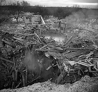 Gomel, Belarus, Ocober 1995..The explosion at the Chernobyl Nuclear Power Plant on April 26 1986 was the worst nuclear accident in history..Bulldozing homes in the closed and radioactive zone surrounding Chernobyl..