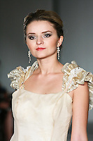 Model walks the runway in a Beth Elis Irisa wedding dress by Nere Emiko during the Wedding Trendspot Spring 2011 Press Fashion, October 17, 2010.