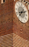 Detail of clock, Torre dei Lamberti (Lamberti Tower), 12th century, Verona Italy. Construction of the 84 metre high brick, tuff brick and marble tower began in 1172. Lightening knocked off the top of the tower in 1403, and it was restored and raised from 1448 to 1463-64. The clock was added in 1779. Picture by Manuel Cohen.
